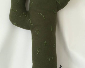Green cactus pillow with gray abstract pompom container