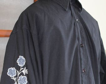 1990s Black cotton button-up shirt embroidered  long sleeves blue and white floral styled in Italy size Medium