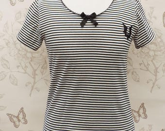 White and black stripes jersey top, bow round collar, with black bat embroidery