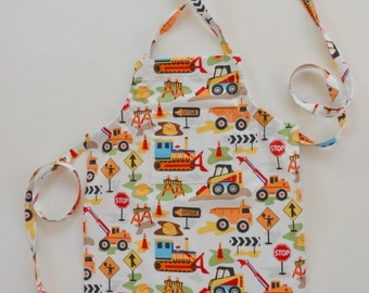 Toddler apron, boy's apron, heavy equipment print, birthday gift, apron with pocket, trucks and loaders, adjustable apron, sizes 1-6.