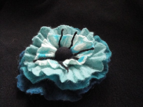 OOAK wet felted flower brooch in turqoise and teal colors made out of 100% Merino wool.