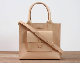 Handstitched natural leather box tote with grab handles and removable shoulder strap. Solid brass hardware. Can be monogrammed