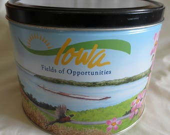 """Vintage """"Iowa Fields Of Oppertunities""""  Popcorn Tin   10"""" Diameter x 7.5"""" Tall Featuring State Flag, Capitol, Flower, and Pella Windmill"""