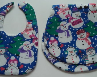 Baby's bib and burp set in a jolly snowman print.