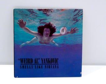 Weird Al Yankovic CD Nirvana band parody Smells Like Teen Spirit DJ only Funny cover art donut under water Waffle King Gag Gift Mohawk Music