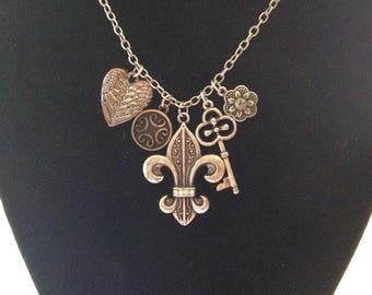 On Sale Antiqued Silver Long Signed Charm Necklace Fleur De Lis