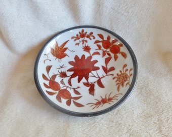 Beautiful white porcelain dish with red and gold floral design with pewter jacket