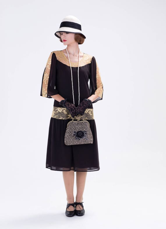 1920s Style Dresses, Flapper Dresses Great Gatsby dress in black and gold $140.00 AT vintagedancer.com