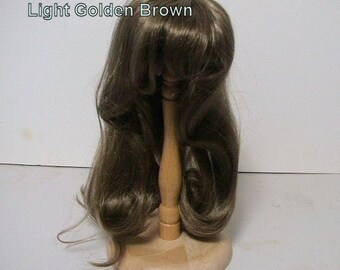 Denise Doll Wig From Monique.  Size is 14-15.  Colors are Lt. Golden Brown and Brown.  Condition is New.