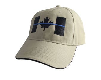 A Canadian Thin Blue Line Symbolic Black Blue Embroidery on an Adjustable Sand Beige and Black Trimmed Structured Adjustable Baseball Cap