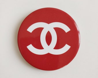 Chanel a pair of logo pins
