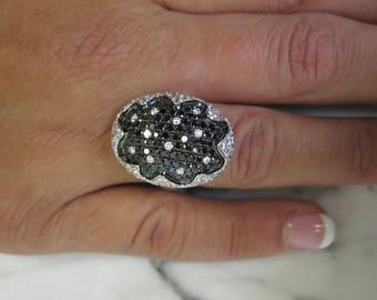 18K White gold black and white diamonds.