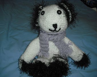 very cute little bear made by hands with yarn in white and black speckled