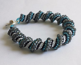 Handcrafted Cellini Spiral Bracelet -- Silvered Blues -- blue, silver, black, white