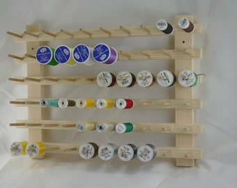 Wall display stand for 60 spools