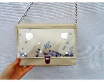 Beige faux leather shoulder bag with shakerabli elements
