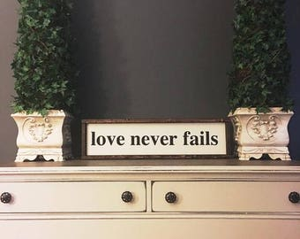 Love never fails painted solid wood sign