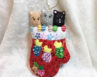 Three cute kittens in a mitten
