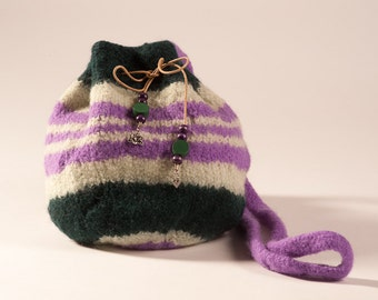 Knitted felted purple and green striped purse.