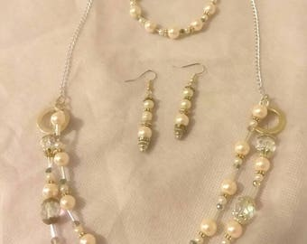 Pearl bead jewelry set. Necklace, bracelet, and earrings