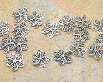 10 or 100 charms flower 5 petals in silver