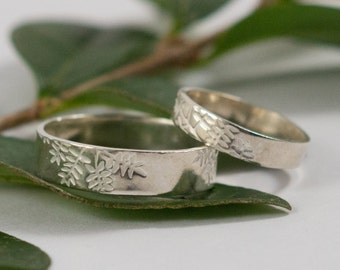 White Gold Botanical Wedding Bands: A Set of his and hers 9k White Gold wedding rings