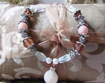 """Hand Crafted PINK CRYSTAL and CONTOURED Beaded 8"""" Bracelet Accented with Silver Tones"""