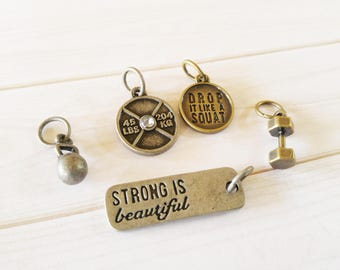 Workout Charms Gym Charms Antiqued Silver Antiqued Bronze Barbell Charm Weight Charm Quote Charms STRONG IS BEAUTIFUL Kettle Bell Charm Set