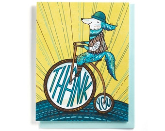 Thank You Card: Dog on an antique bicycle, illustrated and hand-lettered in blue, brown and yellow