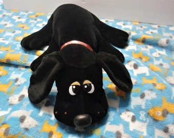 Pound Puppy Puppies Plush dog 18 inch long with all Black fur and nose Soft and cuddly Made by Tonka 1985