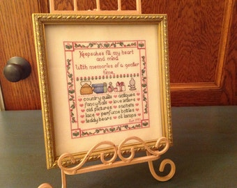 Counted cross - stitch sampler