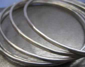 Three Essential Silver Bangles........Hammered Sterling Silver Bracelets