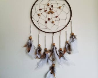 Brown and white quail bird feather native american dream catcher