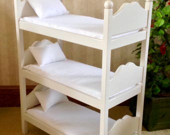 American doll triple bunk bed, oak stained. Ready to ship now. Last one. Being discontiuned.