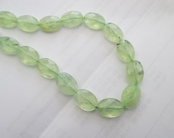 Prehnite or green rutilated quartz: 3 oval flat faceted beads 14 mm * 10 mm