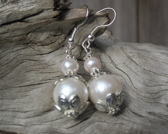 Elegant glass pearl dangle earrings with antique silver details