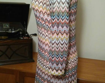 Knee length crocheted dress with 3/4 length sleeves. Missoniesque in style.