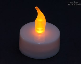 LED candle light with yellow flickering flame