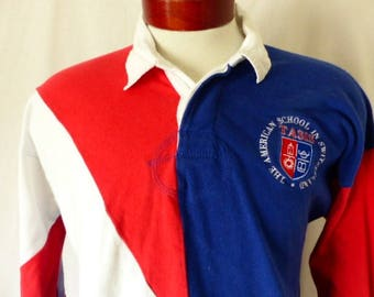 Go TASIS vintage 80's The American School in Switzerland rugby shirt color block asymmetric red white blue panel embroidered logo Large