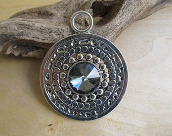 Large round pendant with smoky rhinestone, 73 x 59 mm x 11 mm antiqued silver color metal.