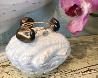 Large black and gold chuncky bead, wire wrapped bangle