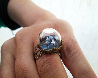 Miniature, highly detailed three dimensional landscape in a real glass dome, adjustable brass ring.