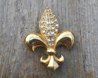 Swarovski Crystal and Gold Tone Fleur de Lis Brooch