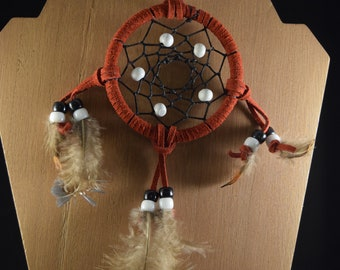 Small red wrapped dream catcher with white and black beads