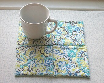 blue yellow and green flowers hand quilted set of mug rugs coasters
