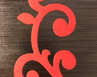 Embellishments in the shape of arabesque smooth red cardstock