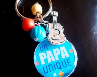 Key ring a unique candy cabochon bead and guitar