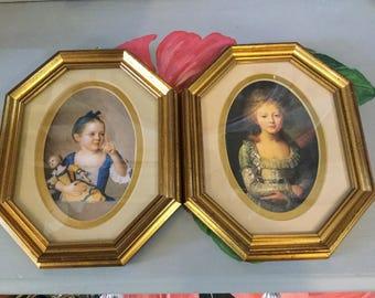 Pair of Gold framed prints