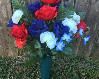Cemetery flowers in ground vase, Memorial Day flowers, red white and blue cemetery flowers