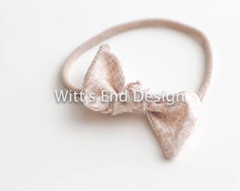 One Size Fits All- Top Knot Elastic Headband/Bow Collection- Rose Gold on nylon or metal clip